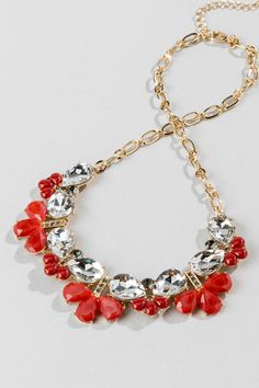 "The Manila Statement Necklace is a perfect way to jazz up your holiday look!  Faceted teardrop crystals are accented by red gems & pewter rhinestones in a simple pattern that draws attention!  Wear this with your party dress & heels for a complete look!<br />  <br />  - Finished with a lobster claw clasp<br />  - 18"" length<br />  - 3.5"" extension<br />  - Lead & nickel free<br />  - Imported"