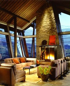 This room by Studio Frank takes rustic chic to a whole new level, with lots of ceiling height windows to bring the amazing view into the room. The outward-leaning windows must give spectacular views of the mountains below.