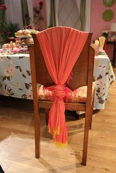 use scarves to dress up chairs