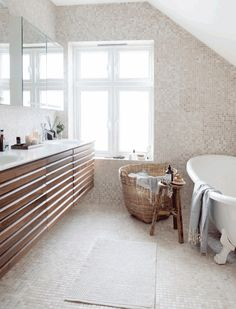 Love the way the tile wraps the floor and walls in this Norwegian bath.  And the vanity floats.