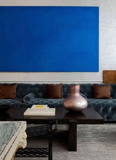 Living room with minimalist blue art. #decor #interior #sofa #modern #abstract #painting #home