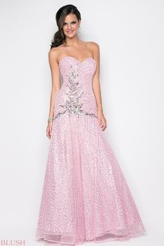 Dramatic bustier in a sexy prom dress! Delicate jewels drape your bodice as they flow into a full skirt.