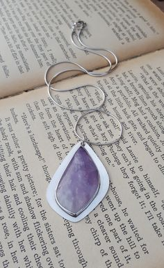 A personal favourite from my Etsy shop https://www.etsy.com/uk/listing/475691534/1970s-fluorite-quartz-sterling-silver