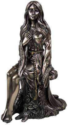 An elegant depiction of the younger form of the Goddess, the Maiden is shown here seated upon a tree stump with delicate hints of color highlighting areas of the bronzed resin statue. The maiden is a