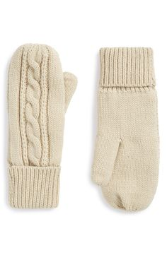 Falling for these snuggly cable knit mittens. They'd be the perfect stocking stuffer for those relatives traveling from out of town.