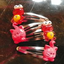 Frogs and kitties hair clips. Metal snap easily   together. fun for any outfit       These do have small parts use caution around little ones. thank you