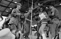 VIETNAM WAR PHOTOS - USO SHOW - RAQUEL WELCH ENTERTAINS THE TROOPS(in a mini-skirt)