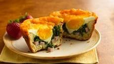 Cheesy Florentine Biscuit Cups - Hmmm ... possibilities.  Not sure my kids would like the spinach for breakfast, but maybe I can figure out what to add in its place.