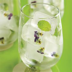 Ice cubes with Flowers- love this!  With some lavender and mint yum! :) Perfect for showers!!