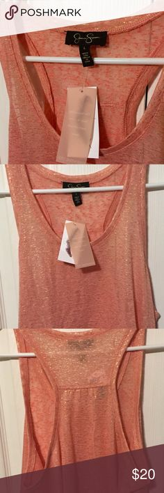 NWT Jessica Simpson racerback Large NWT Jessica Simpson racerback size Large. Peach Color Jessica Simpson Tops Tank Tops