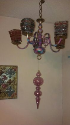 Chandelier. Painted and beaded votive candle holders.