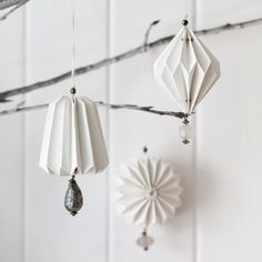set of three pure white, lovely paper decorations