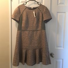 J.Crew Metallic Mixed-Tweed Dress Size 16 J.Crew Metallic Mixed-Tweed Dress. Size 16. Runs a bit small. Flare skirt. Exposed zipper closure on back. Cap sleeves with a small amount of volume. NEVER WORN! Tags attached. J. Crew Dresses