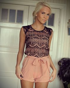 high waisted shorts shows off legs and the textile of the top gives an illusion of solid lace.