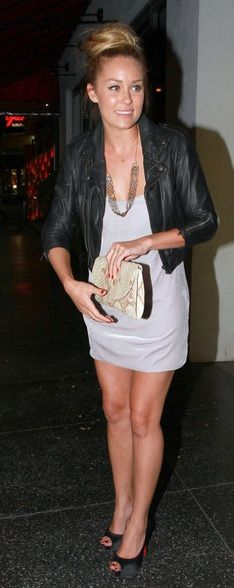 leather jacket and black pumps