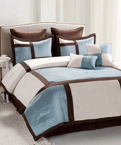 Freshen up the bedroom's focal point with some chic new bedding. This classic set comes complete with a comforter, bed skirt, shams and throw pillows, all of which are stylishly coordinated in a geometric style for a perfectly polished appearance.