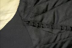 This detail image shows the fine stitching on the interior of this coat. The light colored sleeve lining is carefully stitched to the rest of the lining.