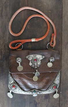 leather bag with silver coins and buckle, rope strap A+V