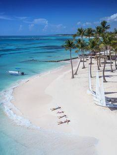 Making sand angels in, Club Med Punta Cana, the Dominican Republic's all-inclusive luxury spot for all.