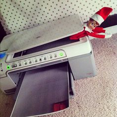 Sticking his elf buns in the copy machine from Little Bit Funky
