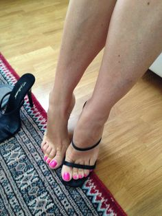 Black strappy mules and great calves