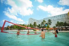 Work out and have fun with a game of pool volleyball at Dreams Sands Cancun Resort & Spa!