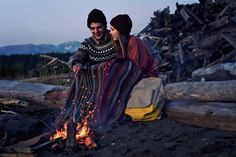 camping -  a couple sitting together near a campfire