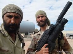 Matthew VanDyke and his friend Nouri Fonas with FN F2000 rifle in Sirte during the Libya War