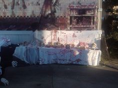 Love this backdrop from Spirit Halloween, it made our butcher shop look even better!