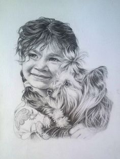 Yorkshire terrier and little girl drawing