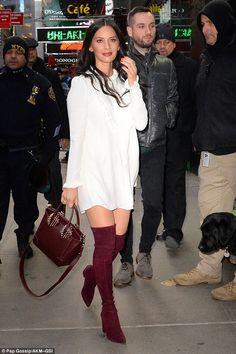 Olivia Munn leggy in a white dress and burgundy boots