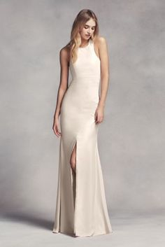 Beautiful Dramatic lines define this long racerback bridesmaid dress with a cutaway halter neckline cowl back