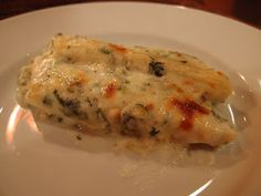 Crab Manicotti with Spinach Cream Sauce - Oh my goodness does this sound delicious!
