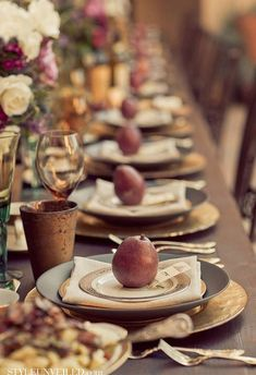 Beautiful rustic fall thanksgiving tablescape. Love the apples used on the gold plates.