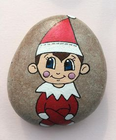 Gorgeous cheeky elf hand painted using acrylic paints onto a pebble. Perfect gift for your elf on the shelf to bring