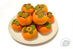 Persimmons, Royalty-Free Images by SchoolPhotoProject.com