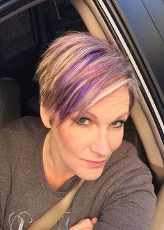 Blonde pixie haircut with purple and fuchsia highlights! Spring is in the air! Cute short hairstyle with color streaks...FUN!