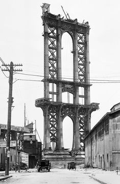 Part of the superstructure of the under-construction Manhattan Bridge rises above Washington Street in New York, on June 5, 1908
