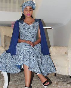 South African Shweshwe Dresses are both simple and elegant; with the unique colors of South African shweshwe dresses that make the girl wearing them look differ African Wedding Attire, African Attire, African Wear, African Women, African Dress, African Beauty, African Clothes, Ankara Dress, African Style