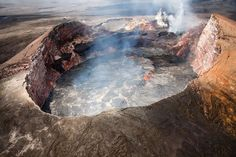 """Aerial view of the perched lava lake in crater roughly translates into """"hill of the  and extinct native bird."""""""