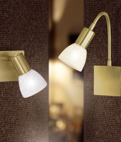 These smart spotlights are available in a satin nickel finish with white lacquered glass.
