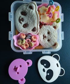 How to Make Quick and Easy Bento Box Snack Idea for Kids | Panda and Bear Ingredients: - Nutella - Peanut Butter - Apple - Bread - Bread Sticks - Fruit Loops - Choko Choko (chocolate cream stick) Tools: - Panda and Bear Cutters - Flower Cutter - Knife - Silicon cups Now a days, it is important to be creative in preparing snack or meal for the kids. The more colorful the meal is, the greater the variety of foods your kids might eat. Making panda and bear faces out of bread is a cool idea.