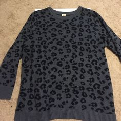 Black & grey leopard Sweater size 18-20W Black and White leopard sweater size 2x 18-20w. Worn once....100 percent acrylic. 28 inches long, 24 inches arm pit to arm pit. Faded Glory Sweaters