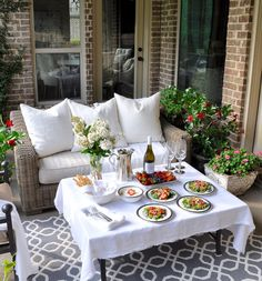 Outdoor patio dinner with flowers white dinnerware and pewter and beautiful salads and fruit-21