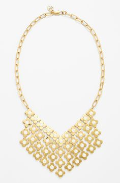 Obsessed with this gold and faux pearl bib necklace. Pairing this Tory Burch beauty will be easy!
