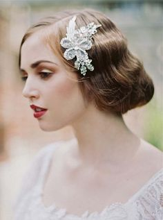 1920's Updo     If you've watched  Downton Abbey 's fourth season, you've seen this wavy updo on Lady Rose. Try this elegant hairstyle on your big day an added retro glam touch.    Image via  Junebug Weddings .