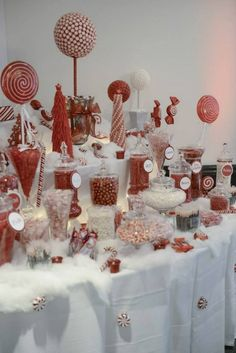 Christmas candy buffet at my wedding. Hand made topiary trees and christmas trees out of candy in the background.