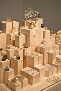 """Simple risers create almost a """"city skyline"""" and can be scaled to fit in a show case. These are carefully cut stock lumber, but paper-wrapped boxes work well too. Try using your consignment shop colors, or use seasonal hues, says http://TGtbT.com, Too Good to be Threw:"""