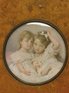 A russian portrait miniature of Grand duchesses Olga, Tatiana and Maria in a wood frame, circa 1900