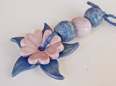 """Set ceramic """" Flower pink and blue """" This set is composed of one ceramic pendant and three beads. By Mª Carmen Rodriguez  https://www.facebook.com/groups/CeramicArtBeadMarket"""